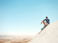 Man sitting on a cliff and desert Royalty Free Stock Photo