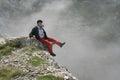 Man sitting on edge Royalty Free Stock Photo