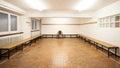Man sitting in empty locker room