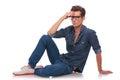 Man sitting on floor & thinking Stock Photo