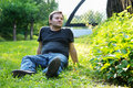 Man sitting on the grass Royalty Free Stock Photos