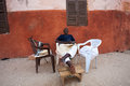 Man sitting and listening to music in the street of the old city saint louis senegal november on a sunday afternoon saint louis a Stock Photography