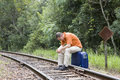 Man sitting on railroad track Stock Photography