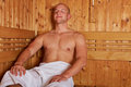 Man sitting relaxed in steam sauna Stock Photos