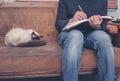 Man sitting on sofa writing ion notebook Royalty Free Stock Photo