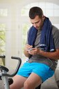 Man sitting on stationary bike Stock Photo