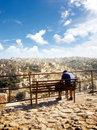 A man sitting at view point amman jordan relaxing Royalty Free Stock Image