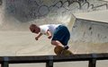 Man is skateboarding middle age enjoys in clissold park london Stock Photography
