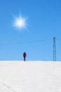 Man with ski on the hill cross country skiing up Stock Photos