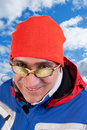 Man skier portrait of the of the in sportswear against the sky Royalty Free Stock Images