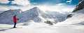 Man skiing on the prepared slope with fresh new powder snow in A Royalty Free Stock Photo