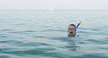 Man skindiving with goggles and snorkel in the sea a just his head visible above the water copyspace Royalty Free Stock Photos