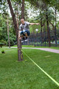 Man in the slackline Royalty Free Stock Image