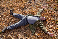 Man sleeping on the autumn field Stock Image