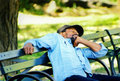 Man is sleeping on a bench in new york usa april unidentified central park Stock Photography