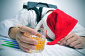 Man sleeping in the office after a christmas party Royalty Free Stock Photo
