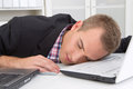 Man sleeping on workplace young Royalty Free Stock Images