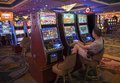 Man at the slot machines playing in a casino in bally s las vegas hotel and casino Royalty Free Stock Image