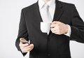 Man with smartphone and cup of coffee close up Stock Photography