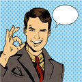 Man smile and shows OK hand sign with speech bubble. Vector illustration in retro comic pop art style Royalty Free Stock Photo