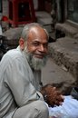 Man smiles for camera lahore pakistan september a bearded as he looks towards the inside the historical walled city of Stock Photography
