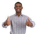 Man smiling giving two thumbs up sign closeup portrait of handsome young at camera isolated on white background positive human Royalty Free Stock Photos