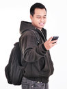Man smiling while holding cell phones and carrying bag isolated on white background Royalty Free Stock Photography
