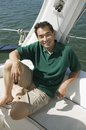 Man smiling on sailboat (portrait) Royalty Free Stock Photo