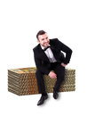 Man smiling sitting on huge stack money smart looking of fifty euro notes wearing tuxedo isolated white background Stock Images