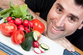 Man Smiling and Vegetables