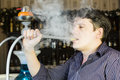 Man smokes a hookah young Stock Photos