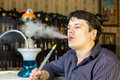 Man smokes a hookah young Royalty Free Stock Photography