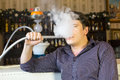 Man smokes a hookah young Royalty Free Stock Image