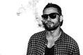 Man smoking cigarette black and white portrait Royalty Free Stock Photo