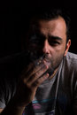 Man smoking dark portrait of cigarette Stock Photography