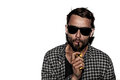 Man smoking e cigarette wearing sunglasses isolated in white Royalty Free Stock Images