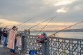 Man Smoking & Fishing on Galata Bridge in early Morning, Wrapped Royalty Free Stock Photo