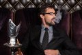 Man smoking shisha in restaurant. Royalty Free Stock Photo