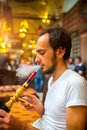 Man smoking turkish hookah Royalty Free Stock Photo