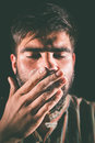 Man sniffing cocaine closeup of a drugged with eyes closed Stock Photo