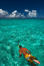 Man snorkeling in crystal clear turquoise water at tropical beach Stock Photo