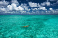 Man snorkeling in crystal clear turquoise water at tropical beach Stock Photos