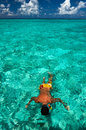 Man snorkeling in crystal clear turquoise water at tropical beach Royalty Free Stock Images