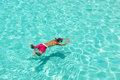 Man snorkeling in crystal clear turquoise water at tropical beach Royalty Free Stock Photography