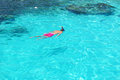 Man snorkeling in crystal clear turquoise water at tropical beach Stock Image