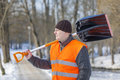 Man with a snow shovel Royalty Free Stock Photos