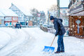Man With Snow Shovel Cleans Si...