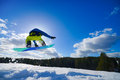 Man on the snowboard young jumping over slope in winter Stock Image
