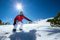 Man snowboarding on sunny winter day Stock Image