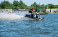 Man on snowmobile goes fast on the water in summer khabarovsk russia july Stock Images